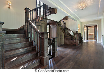 Foyer with dark wood stairway - Foyer in new construction...