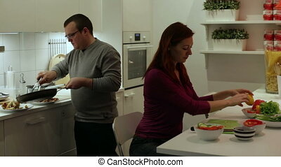 A couple preparing dinner in the kitchen