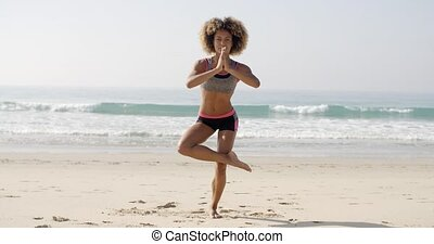 Woman Is Doing Yoga On The Beach
