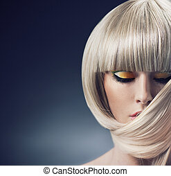 Portrait of a blond lady with trendy coiffure