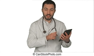 Doctor holding his tablet pc and looking at camera in medical office on white background