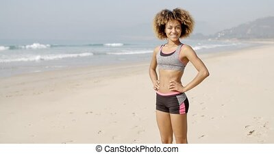 Sport Woman Standing On The Beach