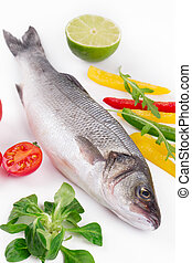 Fresh seabass with lemon and tomatoe on plate Isolated on a...