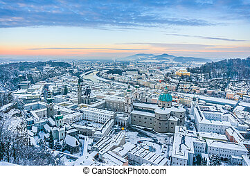 Beautiful historic city of Salzburg in winter at sunset, Austria