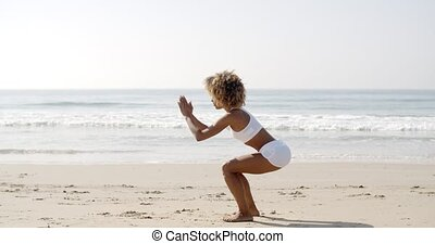 Woman Doing Squat Exercises - Young woman doing squat...