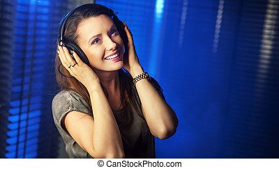 Young sexy woman listening to the music