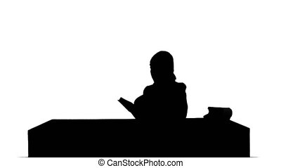 Silhouette Female student reading a book for finding information