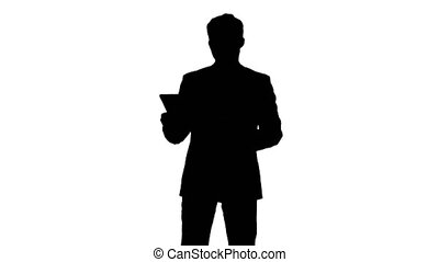 Silhouette Businessman using his tablet