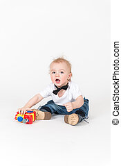Little boy sits with the train toy