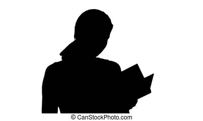 Silhouette Young beautiful girl reading a book on laptop