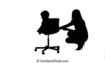 Silhouette Mother and boy play game. Professional shot on...