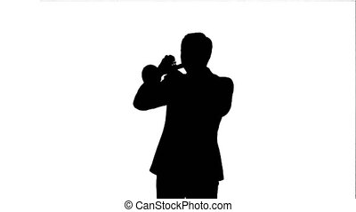 Silhouette Portrait of a young man playing his Trumpet....