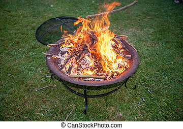 Flames on a garden fire pit - Large Flames flickering on an...