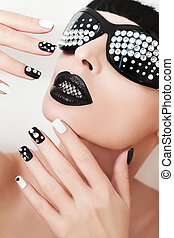 Black makeup and manicure.