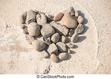 Stone heart - Small stones and pebbles in the shape of a...