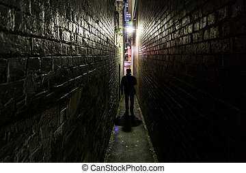 Man silhouette in alleyway - Silhouette of an unrecognizable...