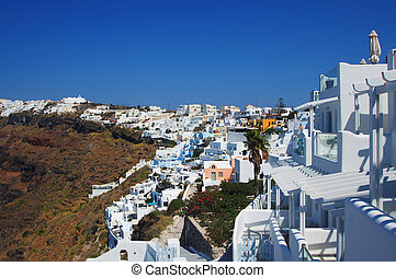 Settlement with beautiful white houses on the hill on...