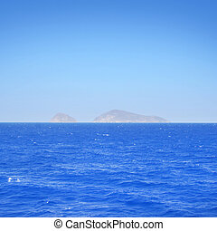 Clear and peaceful sea in Greece with islands on background.