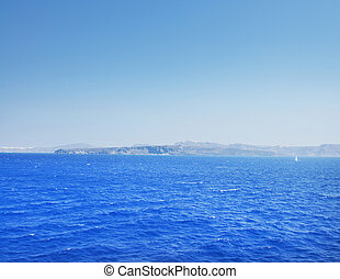 Clear and peaceful sea in Greece with islands on background