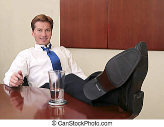 businessman with feet up - one thirties businessman sitting...