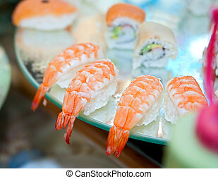 shrimp on a plate - many cooked shrimp on a fancy catered...