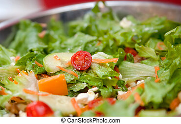 tossed salad - tomatos, cucumber and lettuce in a tossed...
