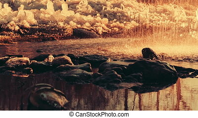 Water splashes in the nature against many ice Close up video...