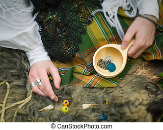Witchcraft - A young girl prepares some things for...