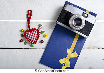 Valentines day toy heart, retro camera and letters Top view...