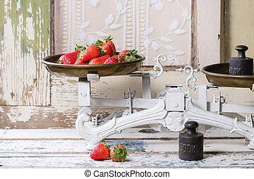 Vintage scales with strawberries