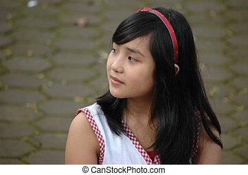 little girl looking for something - little asian girl...