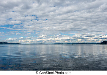 Puget Sound Cloudscape - A layer of clouds floast above the...