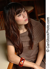 young lady sit down on chair - young asian lady sit down on...