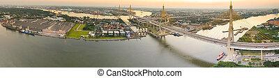 panorama view of bhumibol bridge crossing chaopraya river...