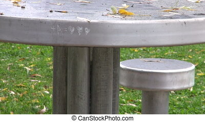 metal bench and table in park - Children playground with...