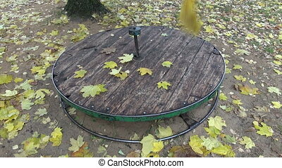leaves on children playground - Yellow maple leaves falling...