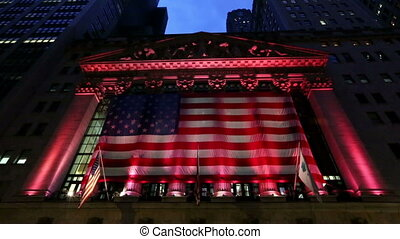 The New York Stock Exchange at Night with American Flag