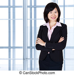 Asian business women standing in office.