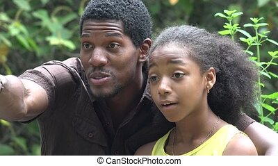 Surprised African Man and Girl