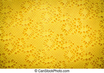 Yellow lace fabric background texture.