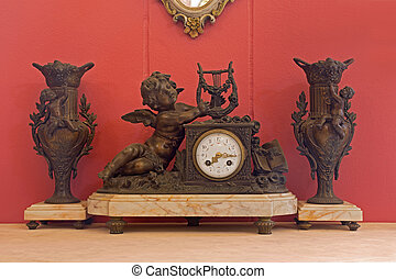 Old clock vintage antique with red wallpaper