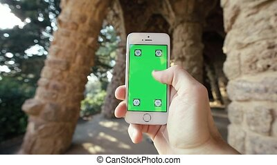 Man Using Phone in Natural Grotto, Parc Guell - Barcelona,...