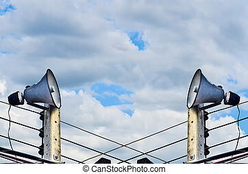 Horn Speaker on blue sky and gray clound