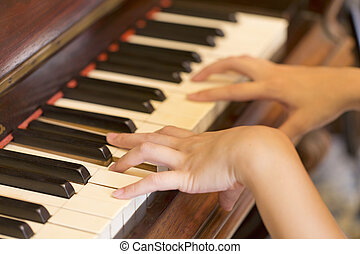 Women Hand playing antique piano classic
