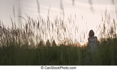 Girl in the field sunset - Girl in the field walking in...
