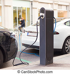 Electric Cars in Charging Station - Power supply for...