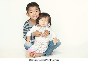brother and sister sitting on knee - Japanese brother and...
