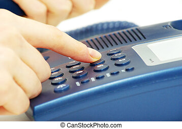 telephone keypad - finger with blue telephone keypad