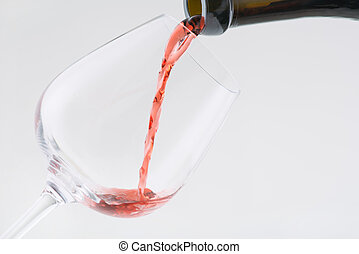 Wine is being poured into the glass. - Red wine. Nice red...