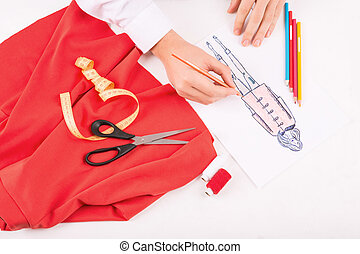 Dressmaker drawing an outfit sketch - Coloring an outline...